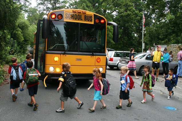 Kids Boarding Schoolbus http://kpel965.com/expert-says-bullying-by-children-linked-to-parental-behavior/